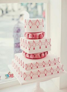 Pink Wedding Cake- Get your dream Parisian-themed wedding with a cake covered in pink piping and macarons.