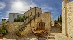 Arcus Luxury Suites Argyroupolis Arcus Luxury Villas is an entire neighbourhood of renovated Venetian stone mansions, located in the heart of the village of Argyroupolis in Rethymno.  The villas have been renovated with respect to their original style and architecture.