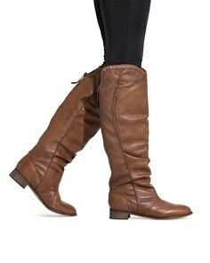 These Ann Boots would be cute paired with a wool trench coat