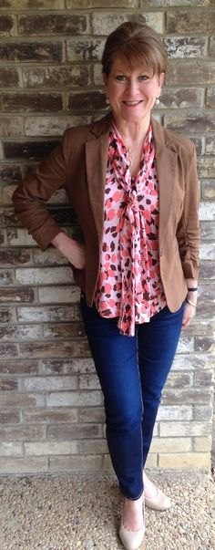 Dress up a basic blazer and skinny jeans with a flowy, floral top