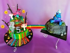 5th birthday cake for my daughter. She picked a DreamWorks trolls themed birthday party. Poppy, Guy Diamond and Biggie and Mr Dinkles figures with rainbows, sprinkles, sparkle hologram glitter, LED lighting effects, leaves, mushrooms, flowers, tie dye swirled fondant cake