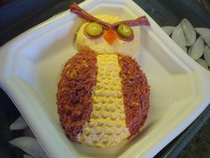 "OWL CHEESE BALL -   Mix 2 pks. cream cheese and one 8 oz tub of spreadable cheddar cheese. Add ½ tsp. worcestershire sauce and ¼ tsp. lemon juice and mix until blended. Add 1 Tbs finely chopped onion. Shape into owl shape. I used chopped beef for the wings. Use the tip of a butter knife to ""ruffle"" the chest. Pepperoni and stuffed olive slices make the eyes. Hard salami, spread with cheese and folded like an accordion, highlight the eyes. A piece of pimento for the beak."