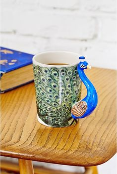 Owner of a Peacock Mug... Time to start a new collection: bird mugs!