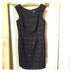 """Beautiful Black and Silver Shift Dress Beautiful Black and Silver Sheath Dress. Super flattering and perfect for day to night. Has sparkle thread pattern woven into it. Size 14. 37"""" long, 7"""" slit in back. 65% poly, 31% rayon, 3% other, 1% spandex. Zip down the back. 302/209/042816 Mossimo Supply Co Dresses Mini"""