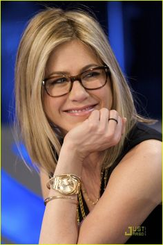 Jen Aniston in OP Wacks cocobolo frames and a gold Rolex
