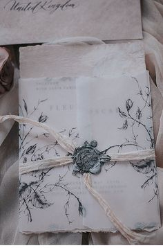 floral vellum wrapped handmade paper calligraphy wedding invitation with wax seal.