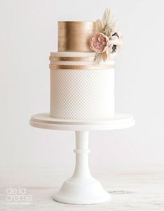 21 Two-Tiered Cakes That Prove Bigger Isn't Always Better - two tiered gold and quilt wedding cake with flower accents