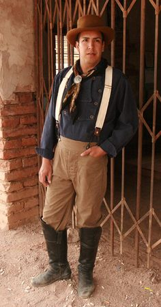 Cowboy Trouser Pants Traditional Cowboy style pants in a cotton canvas duck or denim. These pants have the classic notched waistband, suspender buttons, and button fly. Cowboy Outfits, Jean Outfits, Cowboy Outfit For Men, Vogue Fashion, Mens Fashion, Western Costumes, Trouser Pants, Trousers Mens, Yoga Pants