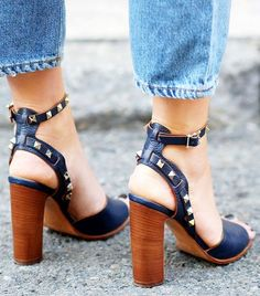 Amazing black heeled sandals with strap. Latest shoes trends.