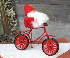 vintage avon products | Vintage Avon Frolicking Santas Ornament Collection, Santa on a Bicycle ...