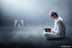 Religious muslim man reading holy quran - Buy this stock photo and explore similar images at Adobe Stock   Adobe Stock Islamic New Year, Muslim Men, Holy Quran, Holi, Adobe, Stock Photos, Explore, Reading, Cob Loaf