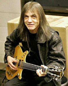 Malcolm Young, the rhythm guitar player and founding member of heavy metal legends AC/DC, has died, according to reports. Blue Soul, Malcolm Young, Ac Dc Rock, Brian Johnson, Angus Young, Band Photography, Rockn Roll, Heavy Metal Bands, Music Guitar