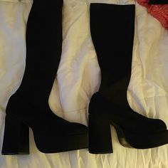 Platform boots Below the knee black platform boots. They have a stretchy fabric to slide them on and they do not sag. No scuff marks. Shoes Platforms