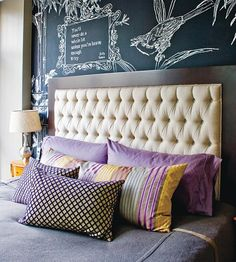 Classic, neutral Headboard with colorful pillows and my fav...fun wallpaper