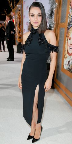 Mila Kunis showed up to the premiere of A Bad Moms Christmas in a seriously stunning black gown featuring a sky-high slit and embellished trim for that added bit of edge. She went sans accessories, opting for just a pair of classic Louboutins.