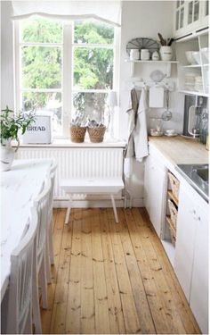 wood floors white kitchen