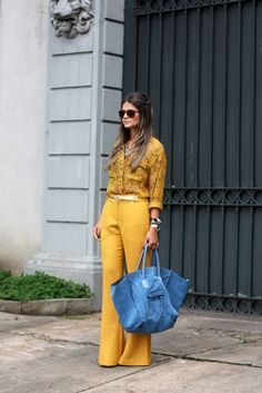 Yellow outfit with a light blue Celine bag is pretty perfect