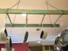 Old wood ladder distressed and painted. Hang and use as a pot rack
