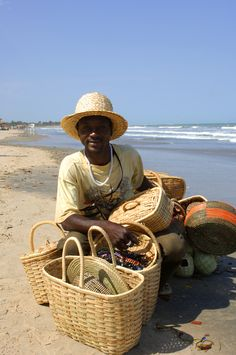 Selling baskets on the beach in The Gambia, West Africa