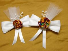 Kente African Wedding Bows, Ethnic Corsage bows, African corsage bows, Favor Bows, African theme weddings. $6.00, via Etsy.