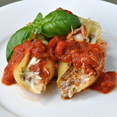 Italian Sausage, basil, mozzarella stuffed shells with marinara
