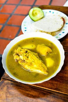 Sancocho de gallina - National dish of Panama. Soup with rooster, corn on the cob, spices served with rice on the side.