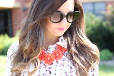 Bug-printed blouse and J. Crew rose necklace