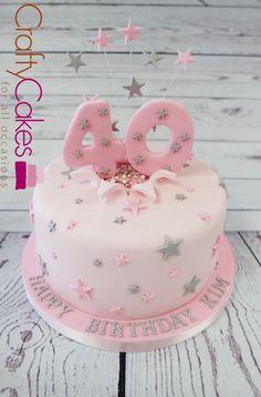 Pretty pink and sliver birthday cake. #pinkandslivercake #starcake #numbercake https://www.craftycakes.com/