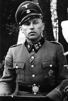 Danish SS-Obersturmbannführer Knud Børge Martinsen photographed in 1943. Martinsen joined Waffen-SS in May 1941, serving with Frikorps Danmark under Christian Frederich von Schalburg in Russia. After Schalburg's death in June 1942, Martinsen took command of the unit and commanded it until March 1943. He was awarded the Infantry Assault Badge, the Wound Badge in Black and both classes of Iron Cross.
