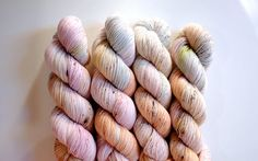 4-Ply Merino: Fiber content: 100% Superwash Merino Wool  4-ply fingering weight  400 meters / 438 yards per 100 gr skein  ----------------------------------------------------------------------  2-Ply Merino Nylon: Fiber content: 80% Superwash Merino 20% Nylon  2 ply fingering weight  365