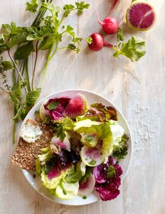 Tender young lettuces, sliced radishes and fresh herbs are tossed with a simple vinaigrette to create a salad that captures the essence of spring.