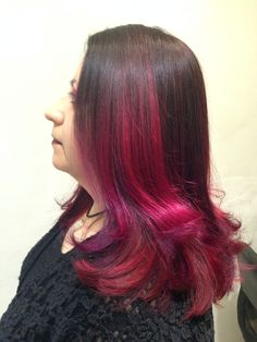 Tricolored color melt with red, fuchsia, and purple. All work and cut by Master Stylist Jamie at Carlton Hair Brea IG: @jamisonsayshello