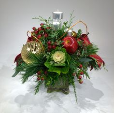 Luscious centrepiece with tiered tea lights will illuminate your festive table.