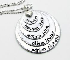 Personalized Mothers necklace that is hand stamped and shows all your blessings in one place. A wonderful necklace with the names of your children or grandchildren. Can be personalized with names of your choice. (put in note to seller) Each letter and design image is individually hammered one strike at a time by me. There are no machines involved and everything is freehand. Because of this, there will be some variations in the spacing, depth of letters and placement. This is not to be…