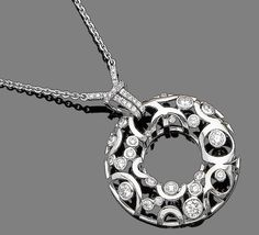 A diamond pendant necklace, by Boodles  The openwork circular plaque, set throughout with brilliant-cut diamonds, suspended from a similarly-cut diamond surmount, to a trace-link chain highlighted by brilliant-cut diamonds, diamonds approx. 1.80cts total, signed Boodles, lengths: pendant 3.5cm, chain 48.6cm