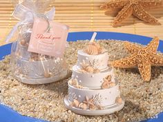 I would never have though of beach themed wedding cake candles...
