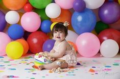 birthday cake smash portrait photographers in Orange County, playing, playing with cake, pink, purple, blue, yellow, white, background, backdrop, polka dot, dotted, sprinkles, first birthday, balloons, balloon, messy, confetti, surprise, party, GilmoreStu