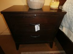 Ethan Allen nightstand in a dark walnut finish with a pull out tray. Measures 26x17x25. Sorry, just one in store. Arrived: Wednesday August 31st, 2016