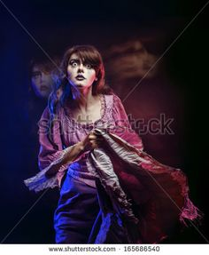 Girl in the image of a witch with a theatrical make-up in studio shot @shutterstock