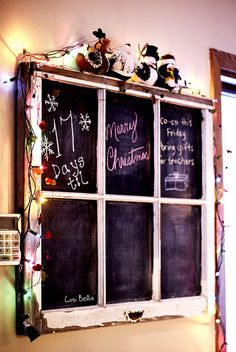 An old window frame turned into a chalkboard - I really like this idea!