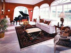 Red and white living room with grand piano