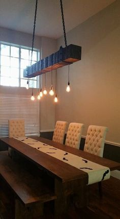 Modern farmhouse lighting made with reclaimed wood beam for a rustic industrial chandelier with light bulbs, perfect lighting for beams idea! This faux bea