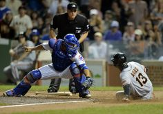 Joaquin Arias #13 of the San Francisco Giants (R) scores past catcher Welington Castillo #5 of the Chicago Cubs on an RBI single hit by Madison Bumgarner during the fourth inning at Wrigley Field on August 21, 2014 in Chicago, Illinois.  (Photo by Brian Kersey/Getty Images)