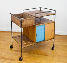 Filed under covetable collectibles: a vintage Arthur Umanoff serving cart.