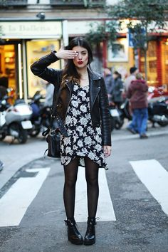 Black and white floral dress, leather jacket, black leather purse, tights and combat boots.