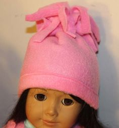 How to make a doll hat with fringe. Make this super easy fleece hat for an American Girl Doll or 18 doll. To make this hat no pattern is necessary.