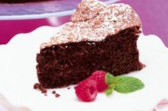 Vegan Almond Chocolate Cake - A cake made entirely without Eggs and Dairy Products and filled with a Vegan Chocolate Ganache. Yet you can't taste the difference. Bring home the recipe and your own cake ! (LessonsGoWhere.com.sg)