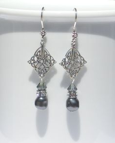 Sterling silver and Swarovski pearl and crystal earrings by ParkhillDesigns on…