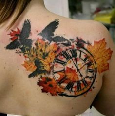 Autumn leaves, rustic clock, and crow tattoo design.