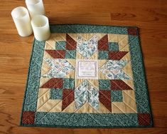 """Double Star Barn Quilt Table Topper or Quilted Wall Hanging """"Home is Where the Hug Is"""" Wm Morris in Green, Gold, and Red 20.5 x 20.5 inch Quilted Table Toppers, Quilted Table Runners, Quilted Wall Hangings, Sewing Studio, Green Fabric, Floral Centerpieces, Machine Quilting, Baby Quilts, Hug"""